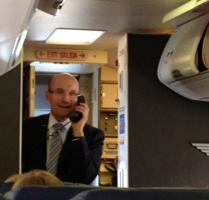 Southwest Airlines Flight Attendant Todd sings for his captive audience.